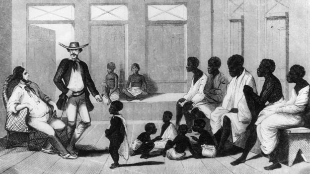 Brazilian slave traders inspect a group of Africans shipped into the country for sale.