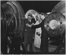 Belgian electrical engineers inspecting the rotor of a 40,000 kilowatt turbine of the General Electric Company in New York City